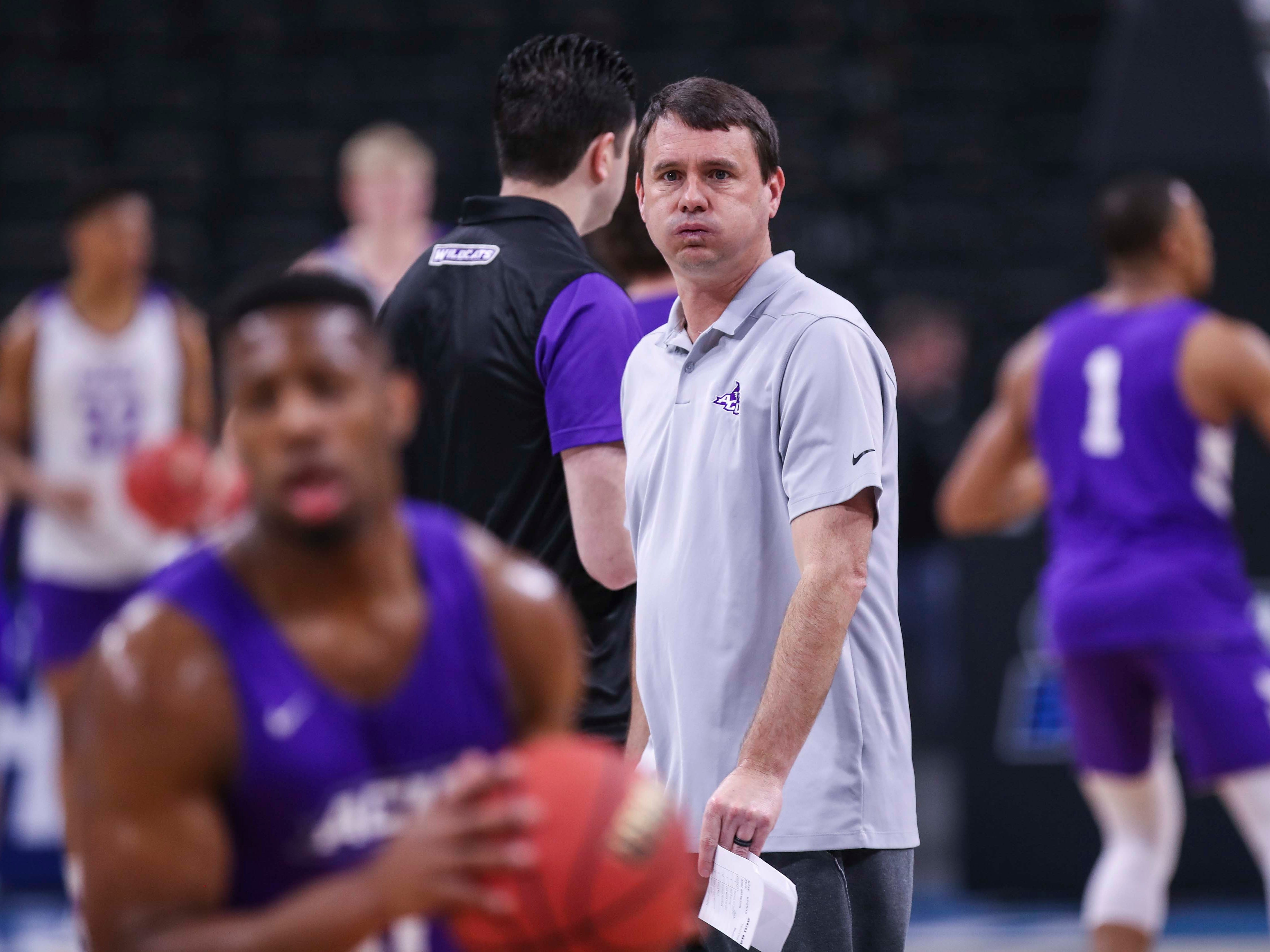 """Abilene Christian head coach Joe Golding watches his team practice Wednesday morning before the start of the Midwest Region of the NCAA tournament. """"If he shows up in a boot we have a chance,"""" Golding said about PJ Washington Jr.  """"If he takes the boot off, we've got a problem."""" March 20, 2019"""
