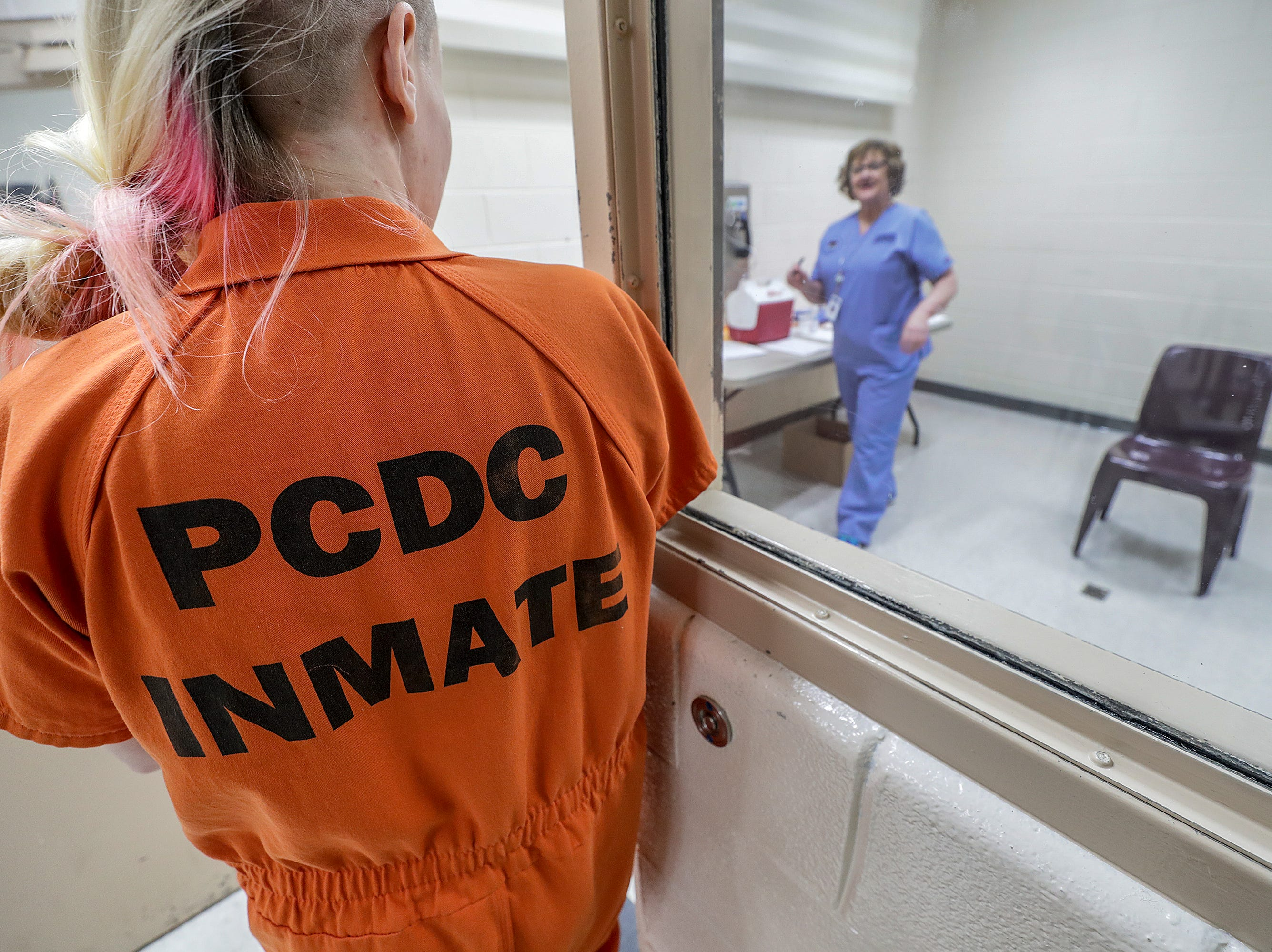 Sharon Wesley, with the Lake Cumberland District Health Department, greets an inmate at the Pulaski County Detention Center.  She vaccinated16 male and female inmates against hepatitis A one afternoon.  About 90 percent of inmates opt to get vaccinated.
