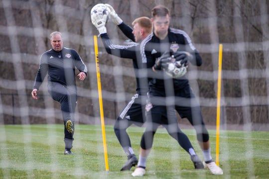 LouCity goalkeepers coach Scott Budnick, left, runs goalies through drills during Wednesday's practice at Thurman Hutchins Park. March 20, 2019