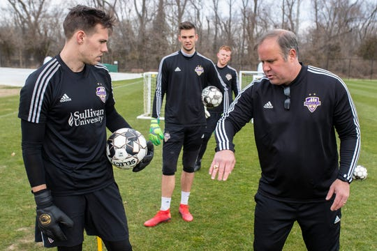 LouCity goalkeepers coach Scott Budnick, from right, discusses a drill with Marc Olsen, Ben Lundt and Tim Dobrowolski during drills during Wednesday's practice at Thurman Hutchins Park. March 20, 2019