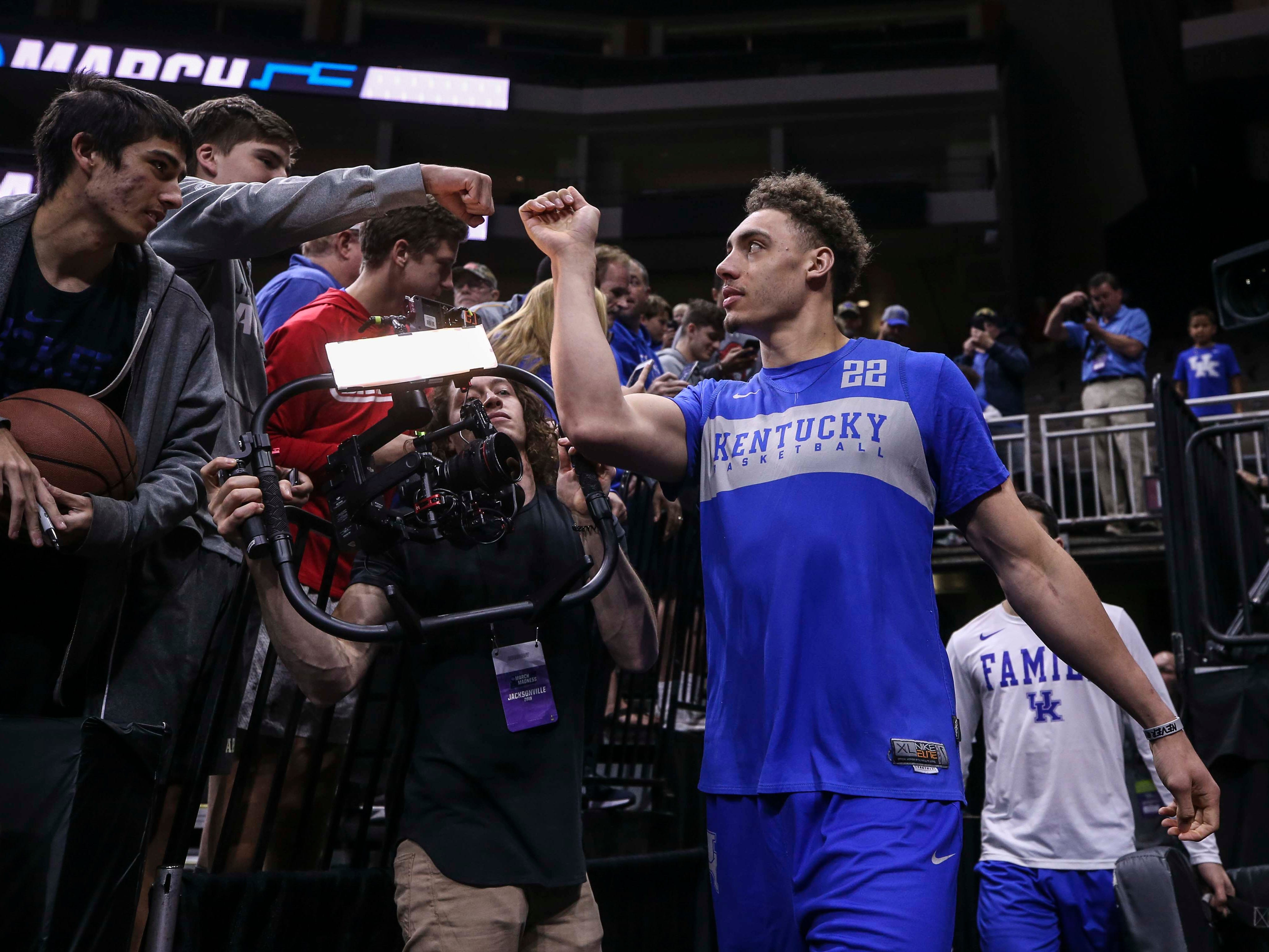 Kentucky's Reid Travis greets fans before the Wildcats' practice Wednesday afternoon in Jacksonville. March 20, 2019