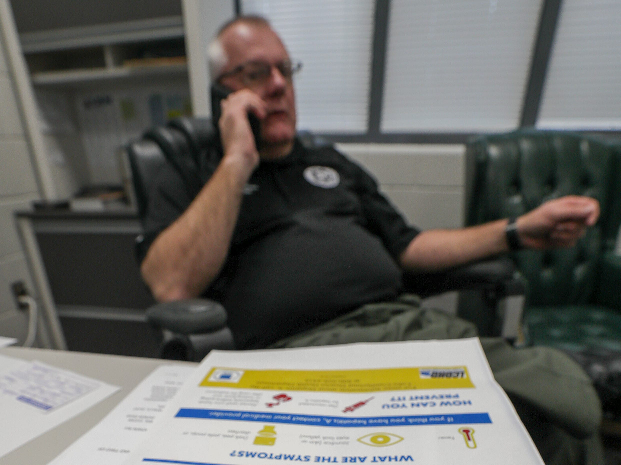 Pulaski County Detention Center Jailer Anthony McCullum talks on the phone in his office at the jail.  He has begun offering vaccinations for hepatitis in his jail after two inmates became ill.  About 90 percent of inmates opt to get vaccinated.