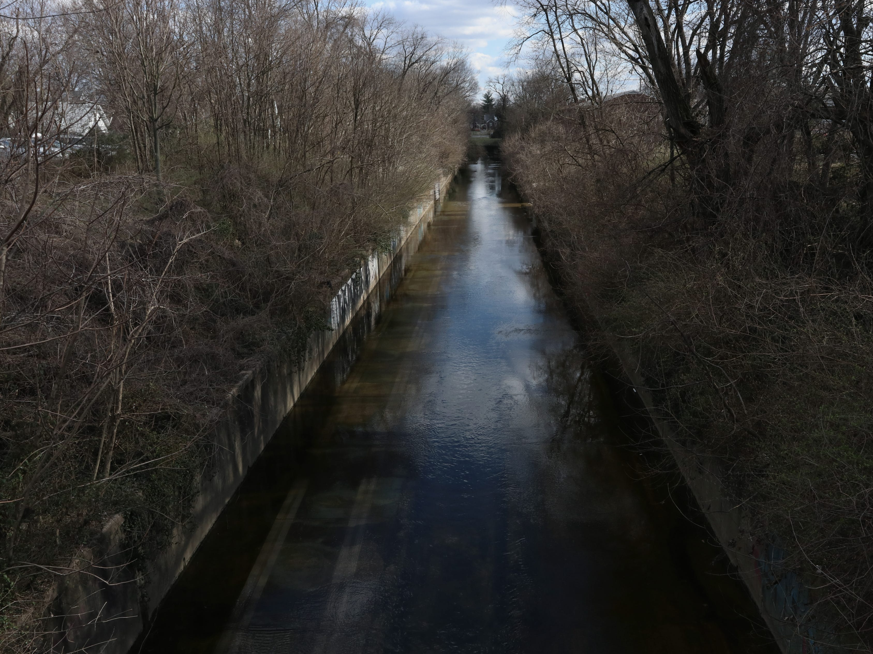 Beargrass Creek runs through Louisville's Germantown neighborhood near the intersection of Barret Avenue and Oak Street.