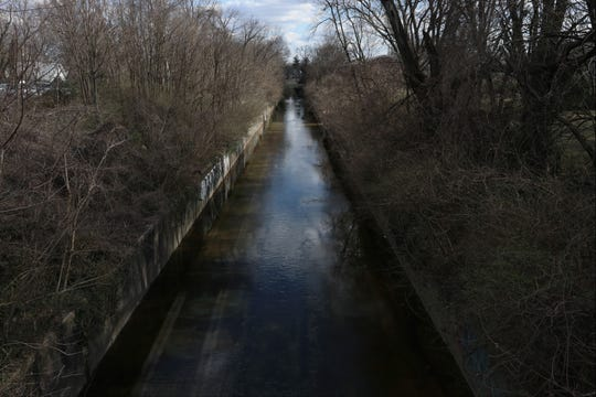 Beargrass Creek runs through Louisville's Germantown neighborhood near the intersection of Barret Avenue and Oak Street.