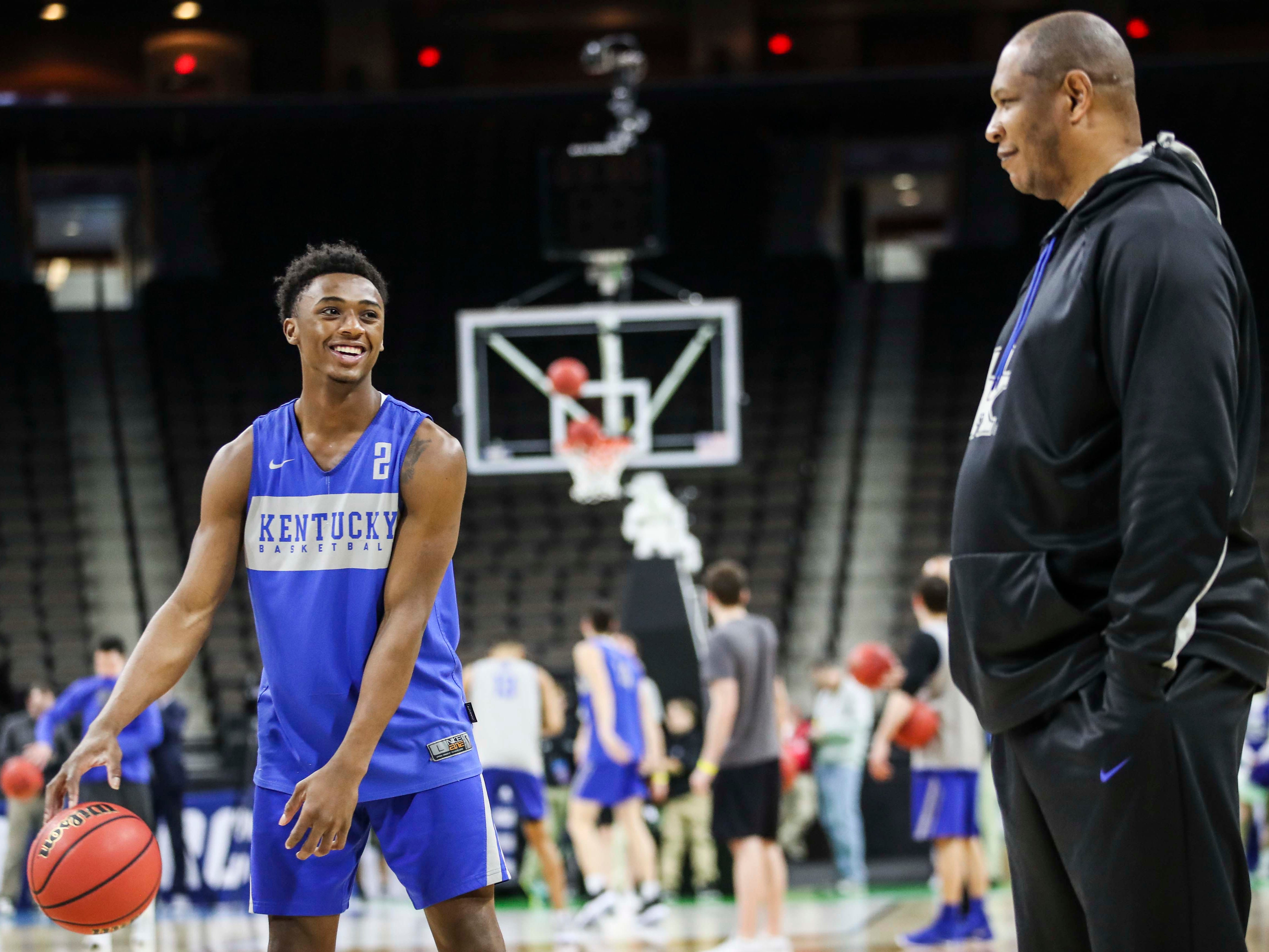 Kentucky assistant coach Kenny Payne looked on as Ashton Hagans laughed during the NCAA tourney practice Wednesday afternoon in Jacksonville. March 20, 2019