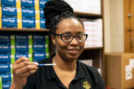 Takeisha Nunez shows a test strip for Fentanyl. She is the syringe exchange program and HIV services supervisor for the Louisville Department of Public Health & Wellness. Feb. 28, 2019