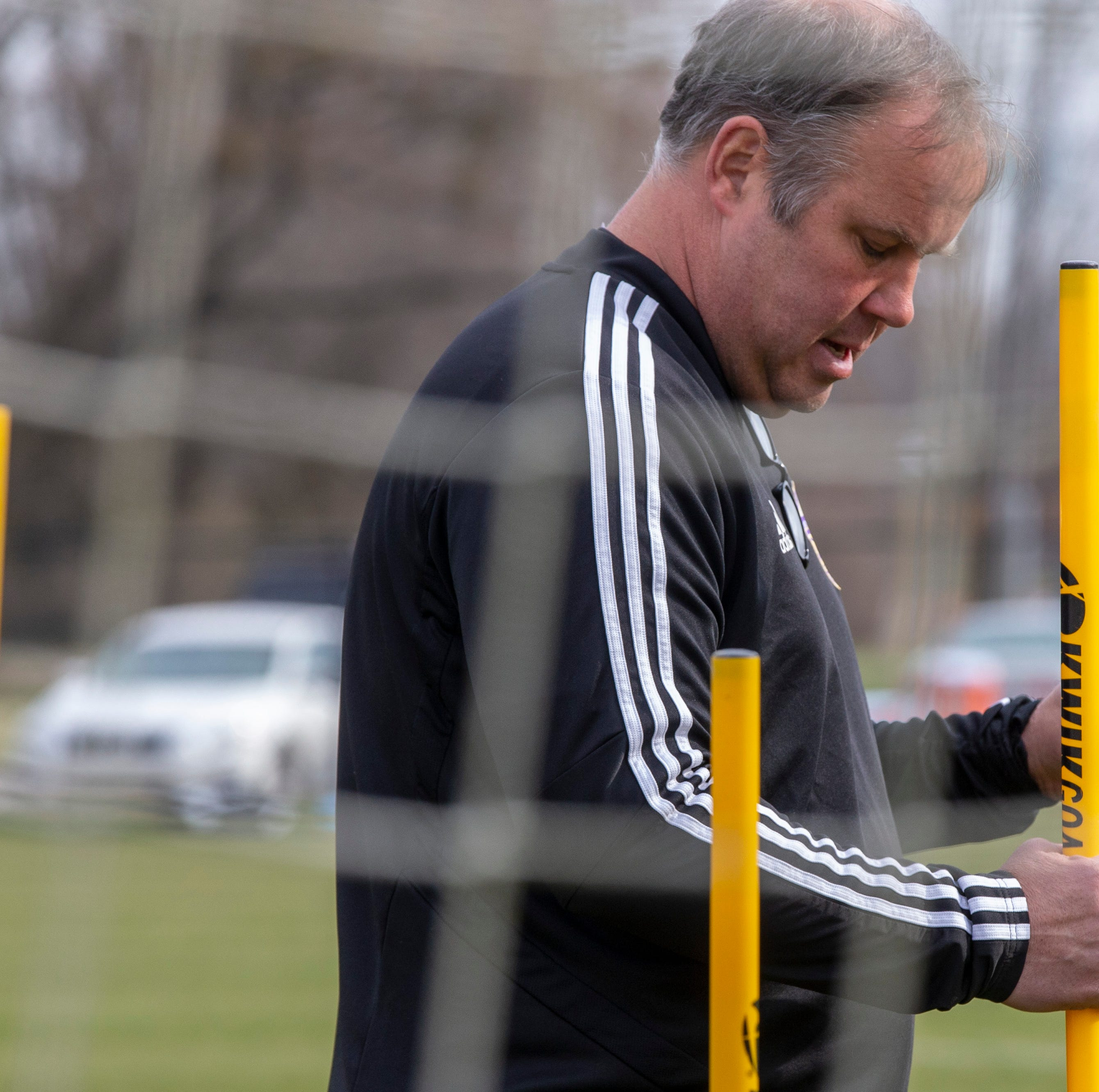 From suit and tie to sweatpants and cleats: A LouCity coach comes full circle