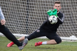 LouCity goalie Ben Lundt stops a shot during Wednesday's practice at Thurman Hutchins Park. March 20, 2019