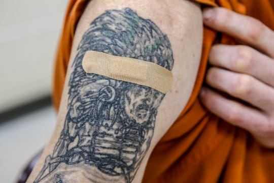 A bandage is placed over the spot where a vaccination against hepatitis A was given to a Pulaski County Detention Center inmate.