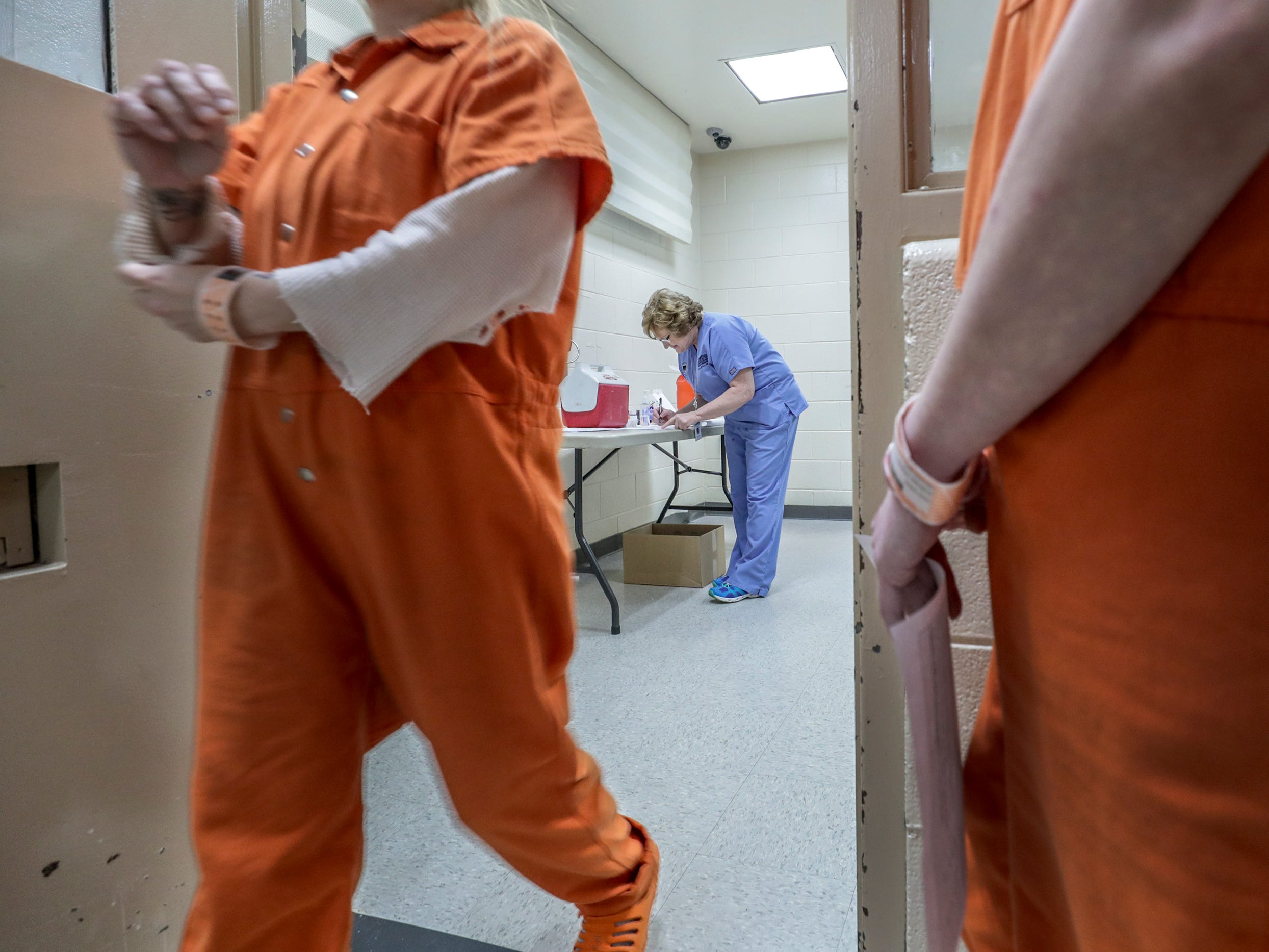 Inmates at the Pulaski County Detention Center wait their turn to get a vaccination from Sharon Wesley from the Lake Cumberland District Health Department.  Wesley vaccinated 16 male and female inmates one afternoon.  About 90 percent of inmates opt to get vaccinated.