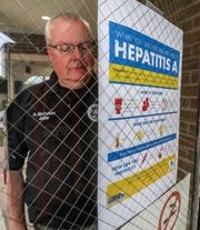 Pulaski County Detention Center Jailer Anthony McCollum looks for a place to hang a hepatitis A vaccination poster at the jail. March 14, 2019