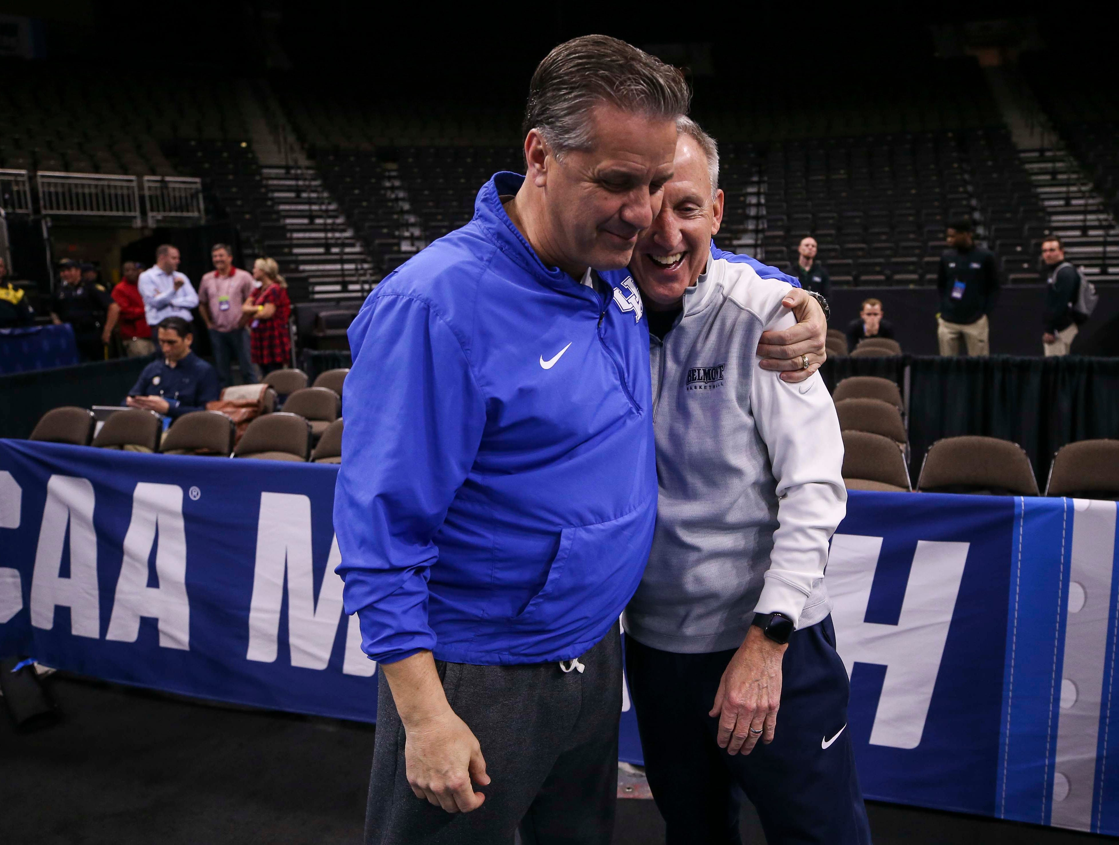 Kentucky's John Calipari greets Belmont head coach Ricky Byrd near the end of the Wildcats' practice Wednesday afternoon in Jacksonville before the start of the NCAA tournament. March 20, 2019
