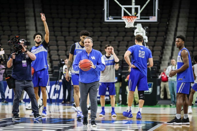 Kentucky coach John Calipari tried a half-court shot -- he didn't make it -- during the NCAA tourney practice Wednesday afternoon in Jacksonville. March 20, 2019