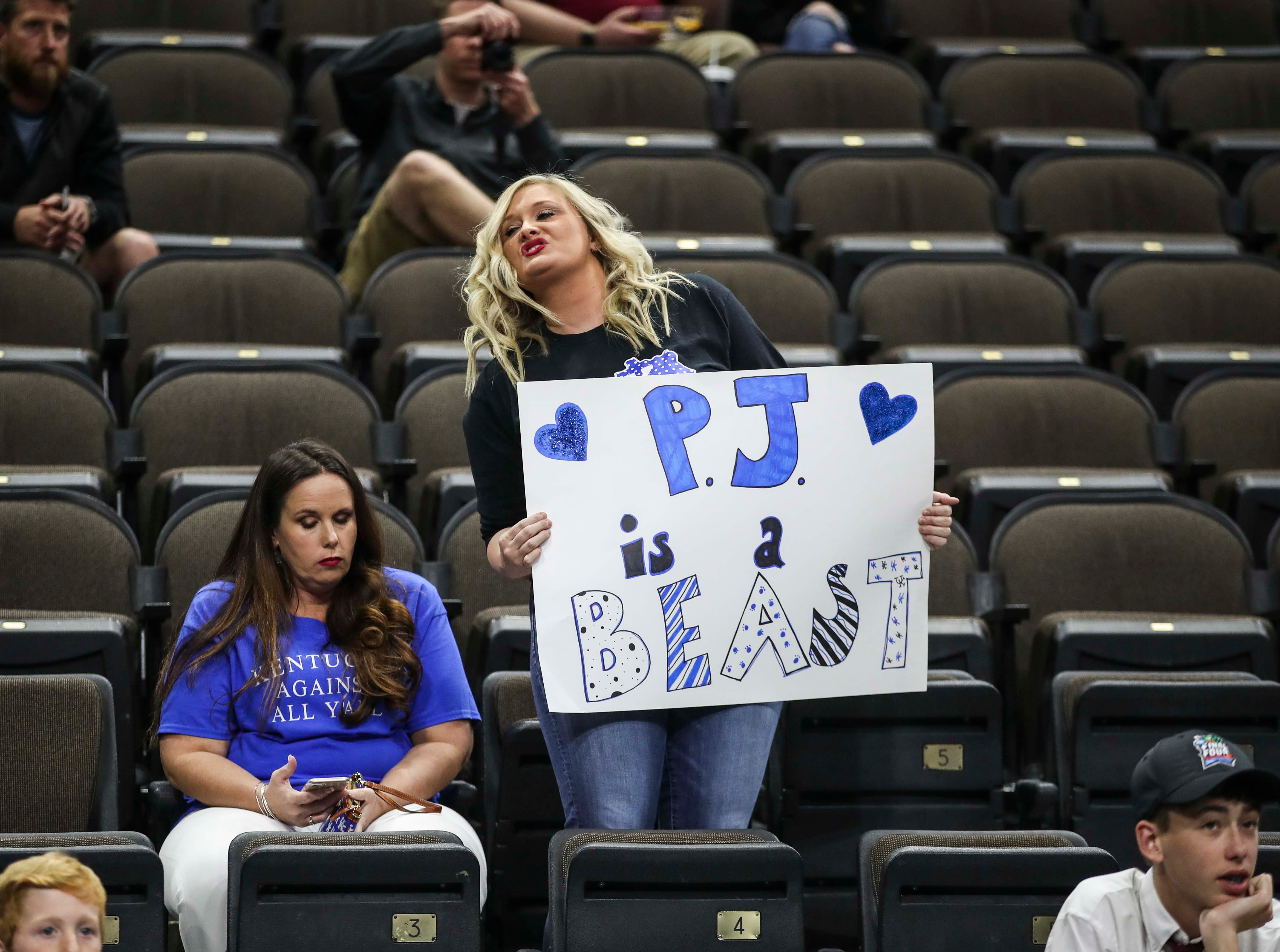 A Kentucky fan held up a sign for an absent PJ Washington Jr. during the NCAA tourney practice Wednesday afternoon in Jacksonville. March 20, 2019