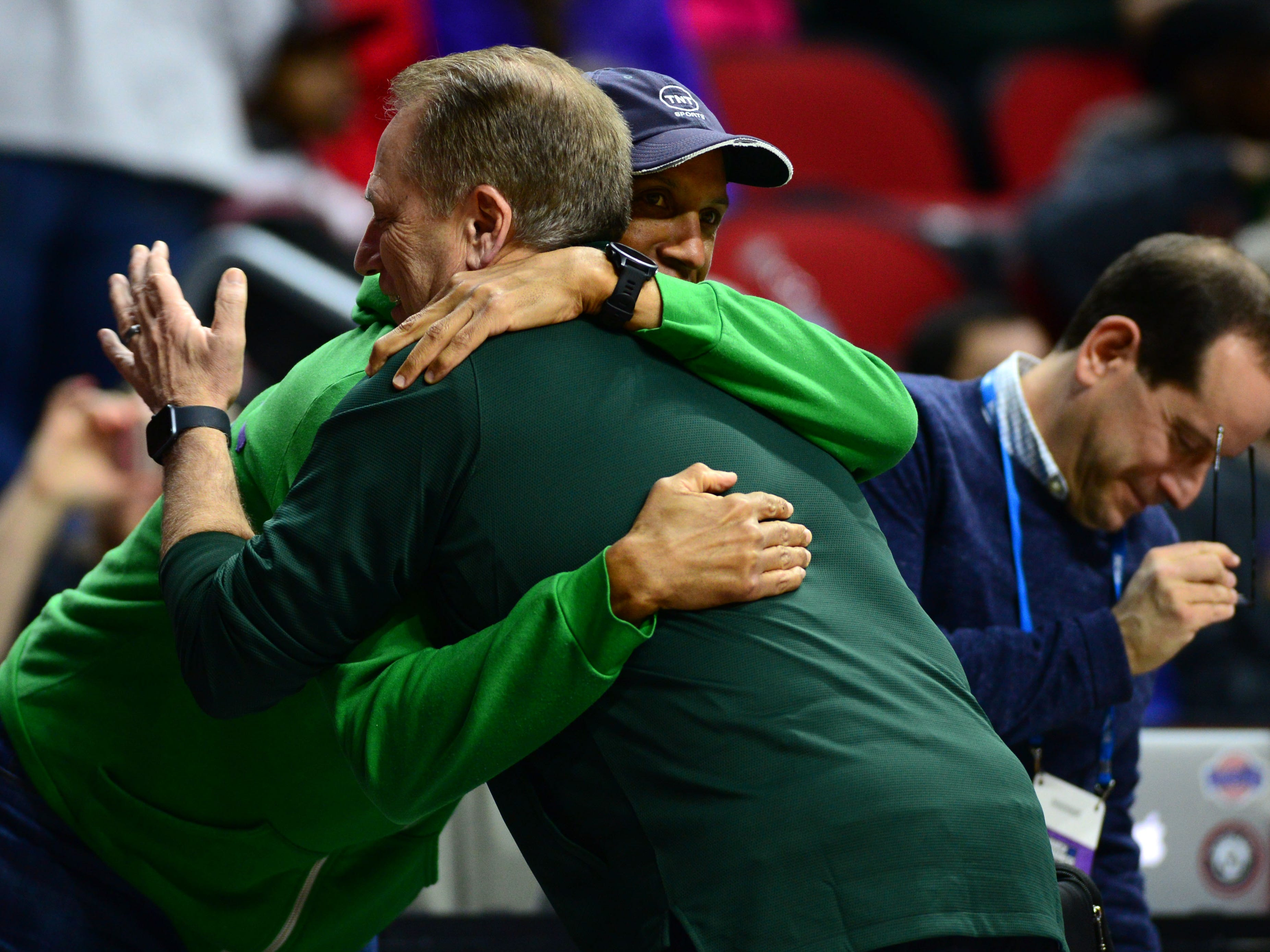 Mar 20, 2019; Des Moines, IA, USA; Michigan State Spartans head coach Tom Izzo hugs TNT analyst Reggie Miller during practice before the first round of the 2019 NCAA Tournament at Wells Fargo Arena. Mandatory Credit: Jeffery Becker-USA TODAY Sports