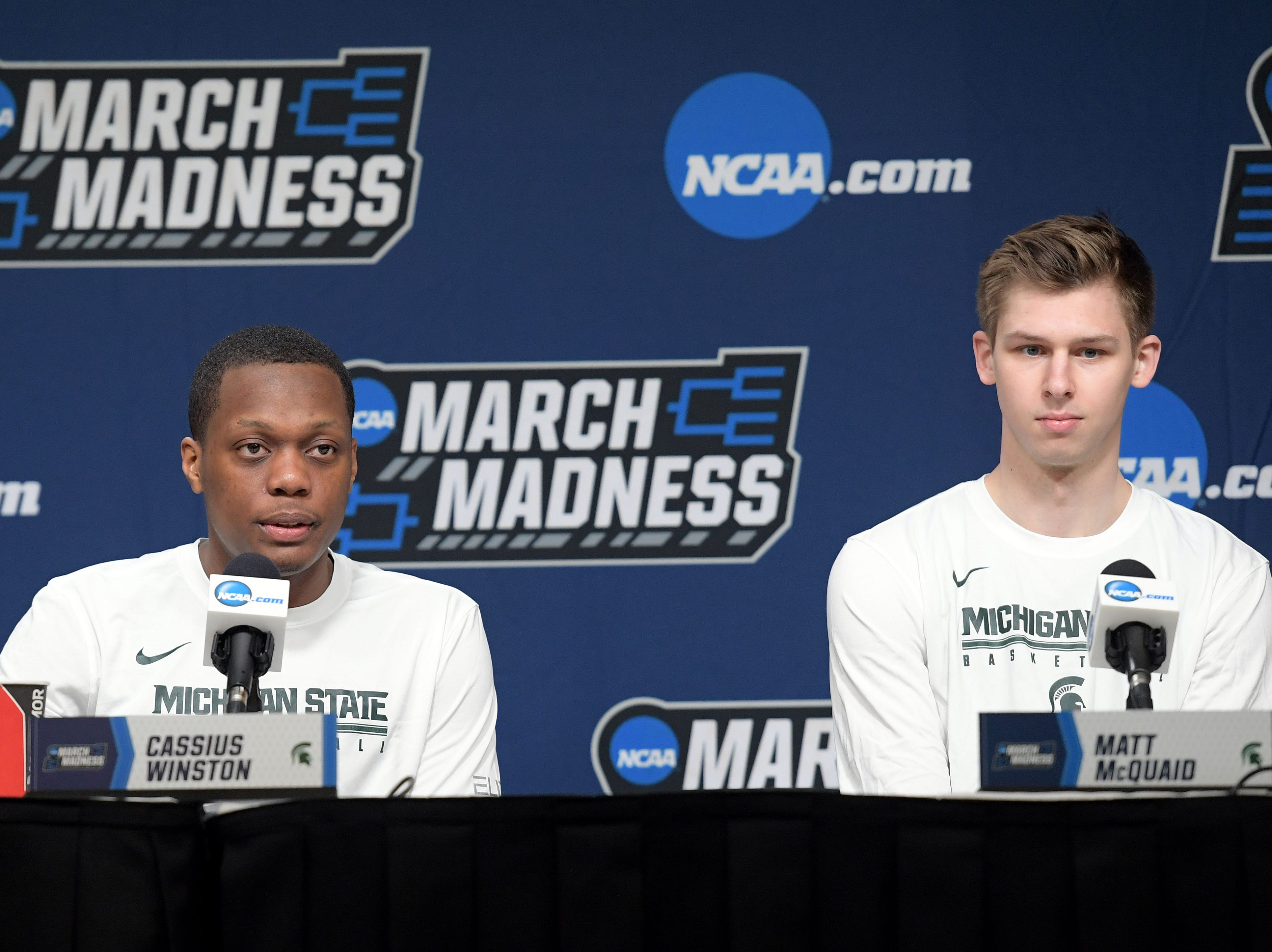 Mar 20, 2019; Des Moines, IA, USA; Michigan State Spartans guard Cassius Winston (5) and guard Matt McQuaid (20) speak in a press conference during practice before the first round of the 2019 NCAA Tournament at Wells Fargo Arena. Mandatory Credit: Steven Branscombe-USA TODAY Sports