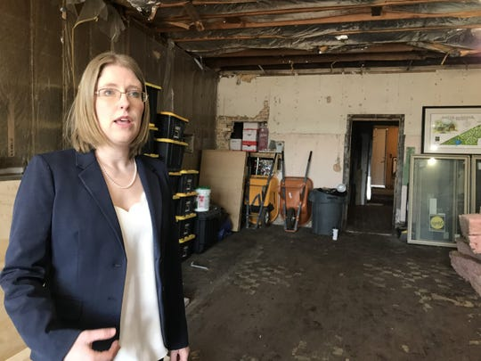 Justine Bell talks about plans for the creation of The Trendy Tabby Cat Cafe at a vacant business space in Lansing's Old Town on Tuesday, March 19, 2019. The concept would offer a place for guests to interact with adoptable cats while drinking coffee.