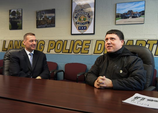 Xavier DeGroat, 28, right, of Delta Township chats with Lansing Police Department Chief Mike Yankowski, Monday, March 18, 2019, about an upcoming event DeGroat has organized to talk to the public about autism awareness and interactions with law enforcement.
