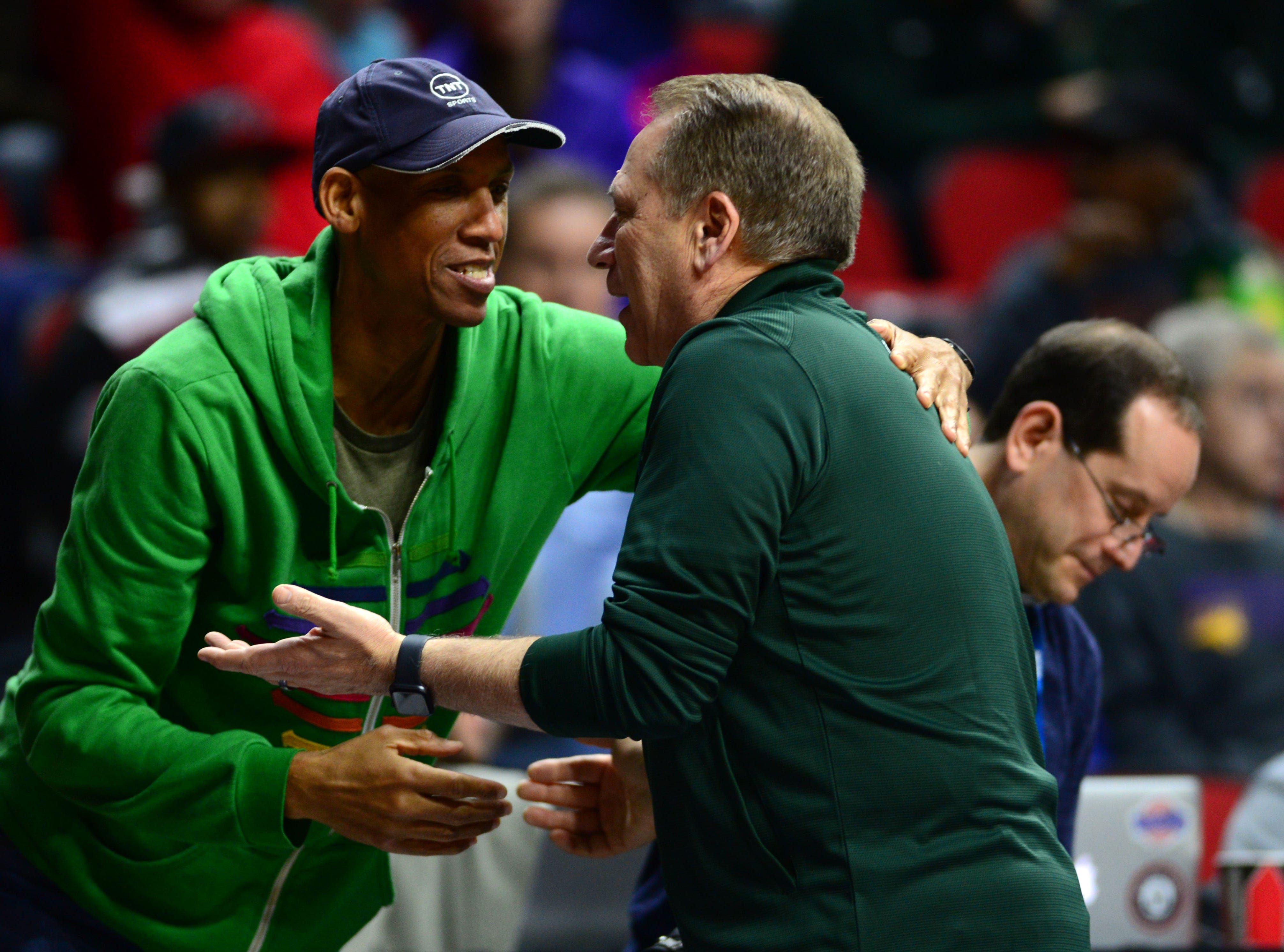 Mar 20, 2019; Des Moines, IA, USA; Michigan State Spartans head coach Tom Izzo hugs TNT analyst Reggie Miller during practice before the first round of the 2019 NCAA Tournament at Wells Fargo Arena.