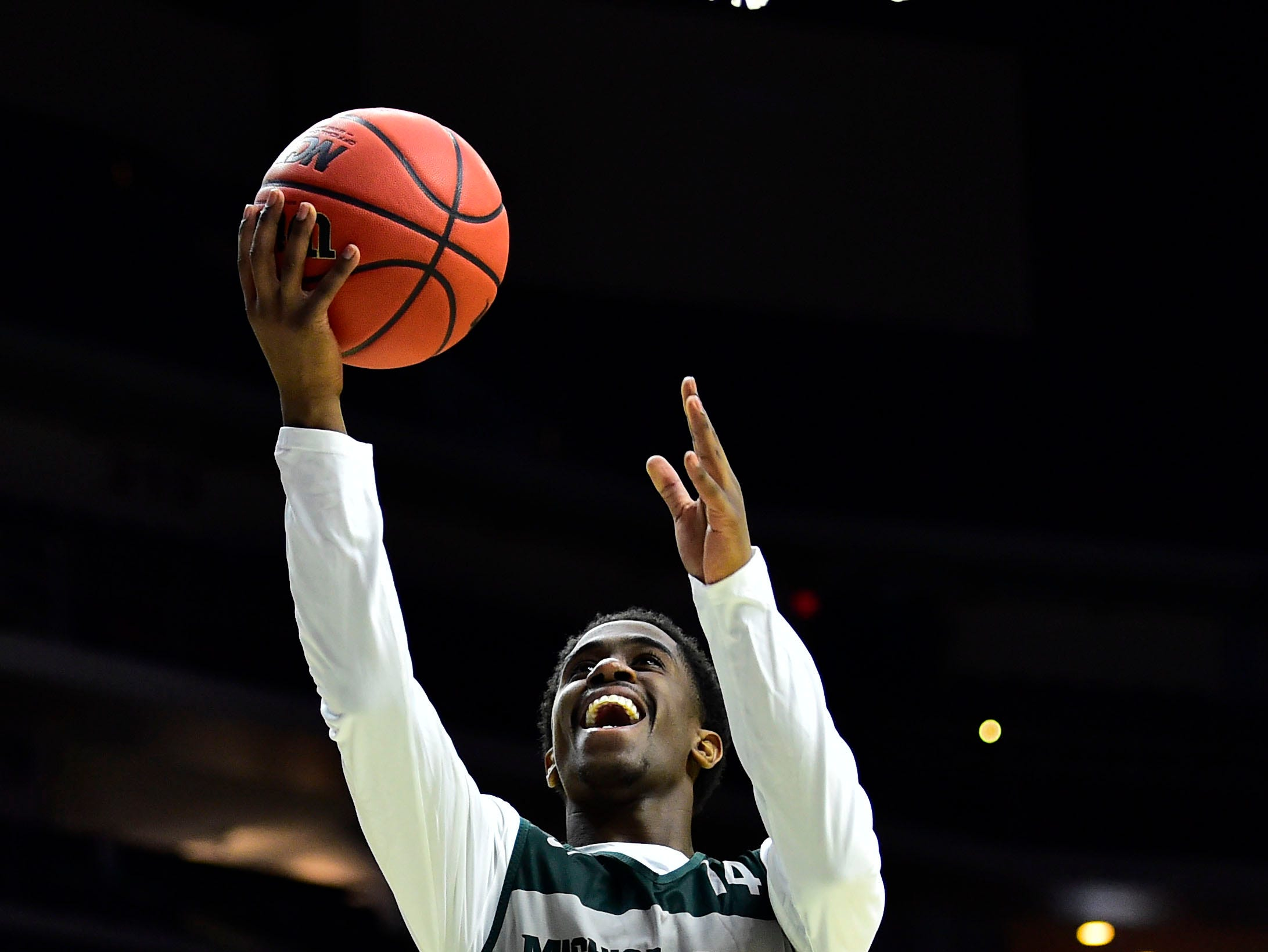 Mar 20, 2019; Des Moines, IA, USA; Michigan State Spartans guard Brock Washington (14) shoots the ball during practice before the first round of the 2019 NCAA Tournament at Wells Fargo Arena. Mandatory Credit: Jeffery Becker-USA TODAY Sports