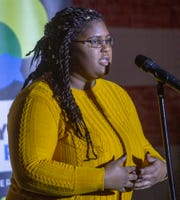 Jillian Johnson,Lansing Promise Scholar, tells her story about going away to college Tuesday evening, March 19, 2019, at Lansing Brewery Company