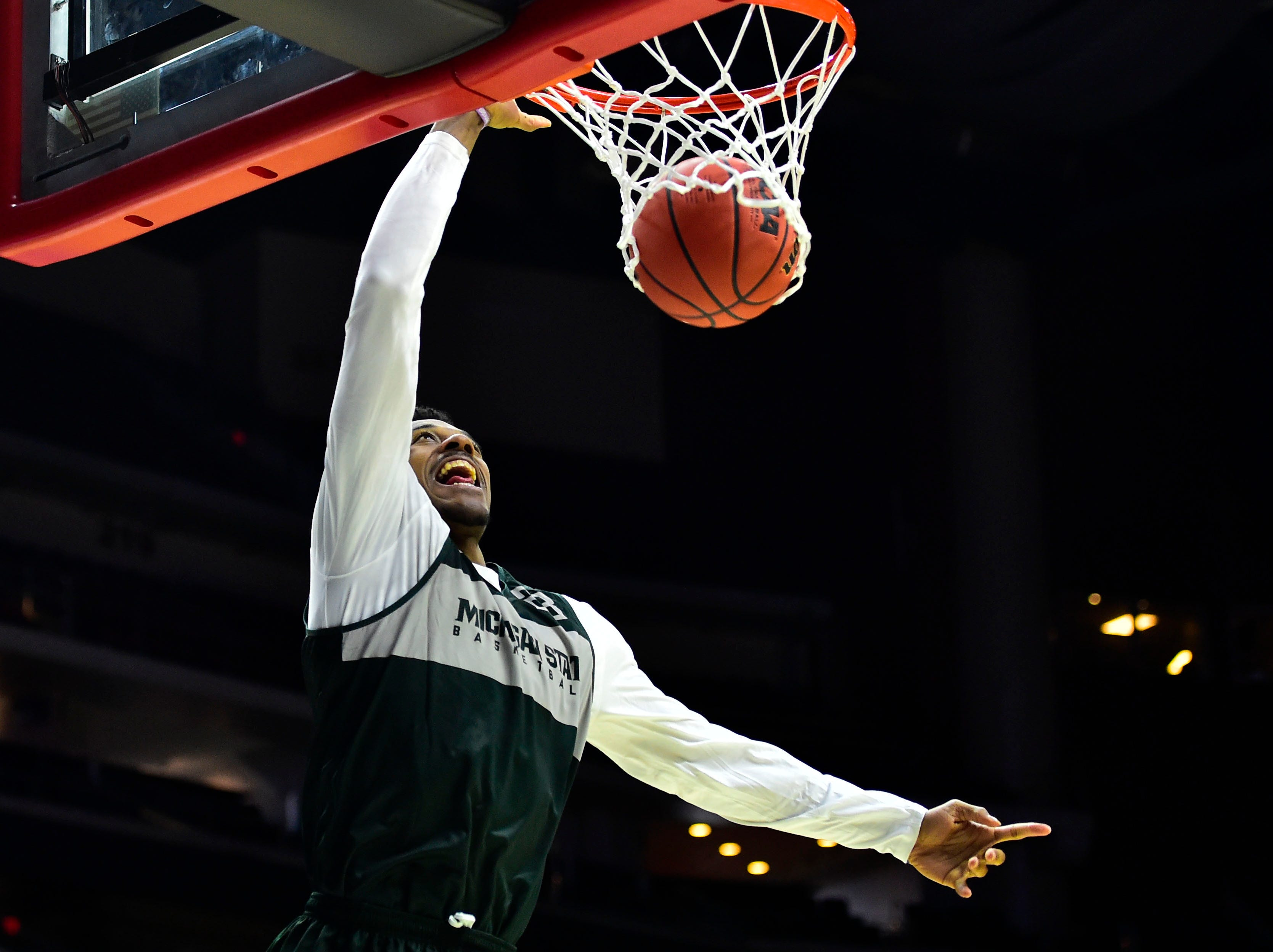 Mar 20, 2019; Des Moines, IA, USA; Michigan State Spartans forward Xavier Tillman (23) dunks the ball during practice before the first round of the 2019 NCAA Tournament at Wells Fargo Arena. Mandatory Credit: Jeffery Becker-USA TODAY Sports