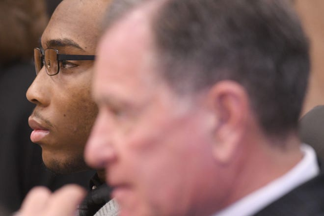 Khairi Bond and his attorney Jack Bradley listen to testimony during Bond's murder trial in Richland County Common Pleas Court.