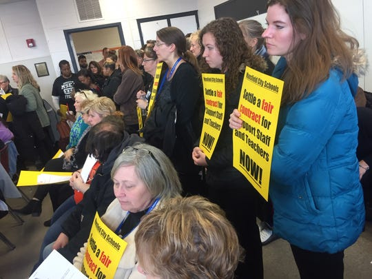 More than 100 teachers and staff members visited Tuesday's school board meeting in support of renewing their contract with the district.