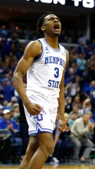 Memphis Tigers guard Jeremiah Martin (3) celebrates his dunk during the second half in their first round NIT game against San Diego at the FedExForum, Tuesday, March 19, 2019.