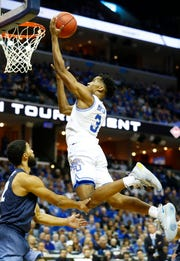 Memphis Tigers guard Jeremiah Martin (3) goes in for two points in front of San Diego Toreros guard Isaiah Wright (22) during the first half of their first round NIT game at the FedExForum, Tuesday, March 19, 2019.