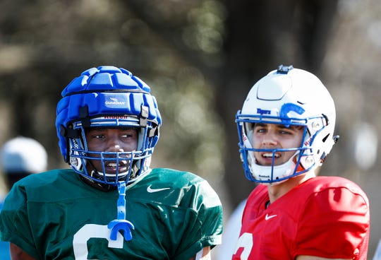 Memphis teammates Patrick Taylor Jr. (left) and Brady White (right) during spring football practice.