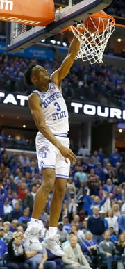Memphis Tigers guard Jeremiah Martin (3) completes a fast-break dunk during the second half n in their first round NIT game against San Diego at the FedExForum, Tuesday, March 19, 2019.