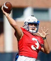 Memphis quarterback Brady White makes a pass during spring football practice drills.