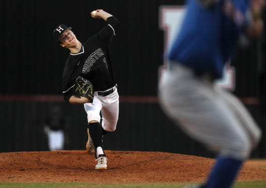 Houston's Grayson Hitt pitches against Bartlett during their game at Houston High School on Tuesday, March 19, 2019.