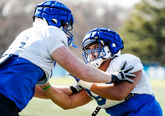 Memphis offense lineman Dustin Woodard (right) during spring football practice.
