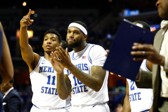 Memphis Tigers guard Antwann Jones Jr. (11) and forward Mike Parks Jr. (10) celebrate on the bench during the second half in their first round NIT game against San Diego at the FedExForum, Tuesday, March 19, 2019.