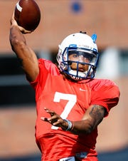 Memphis quarterback Markevion Quinn runs through drills during spring football practice.
