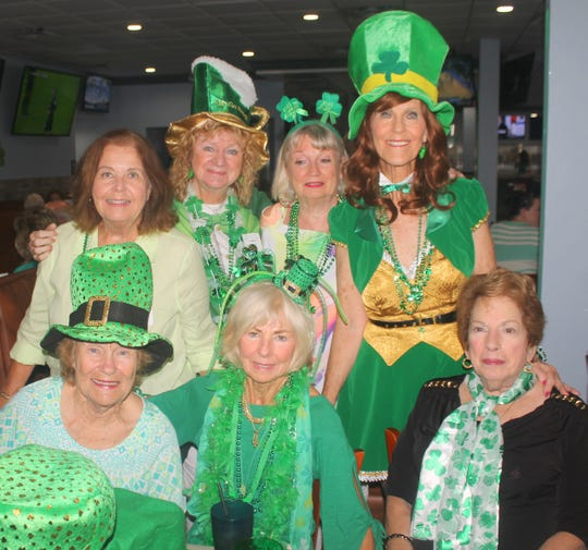 Irish lassies, seated, are MaryAnn Cassidy, Susanne Grossman and Ginny Jermanok; standing: Donna Reily, Cindy Crane, Maureen Welch and Susie Walsh.