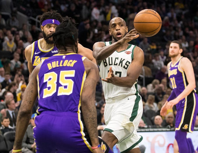 Bucks forward Khris Middleton passes the ball to the corner in the third quarter. Middleton had 30 points Tuesday night.