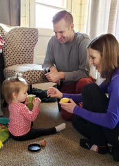 Vienna Ambroch, 1, plays with pretend food with her parents Ben and Maura on March 18 in Wauwatosa.