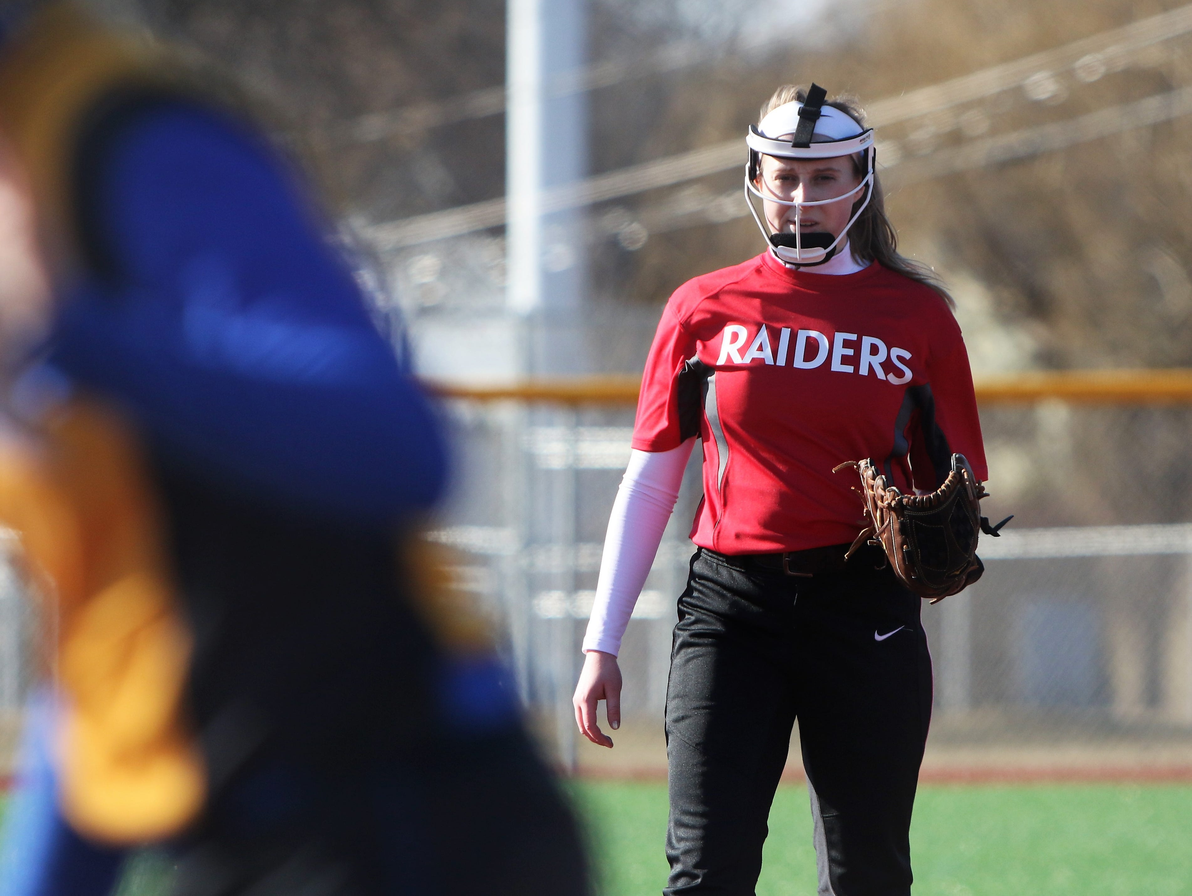 Wauwatosa East pitcher Stasia Raebel looks in for a signal from her catcher during a season-opening game against Catholic Memorial on March 19, 2019.