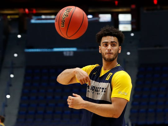 Marquette guard Markus Howard tosses the ball during practice at the XL Center on Wednesday.