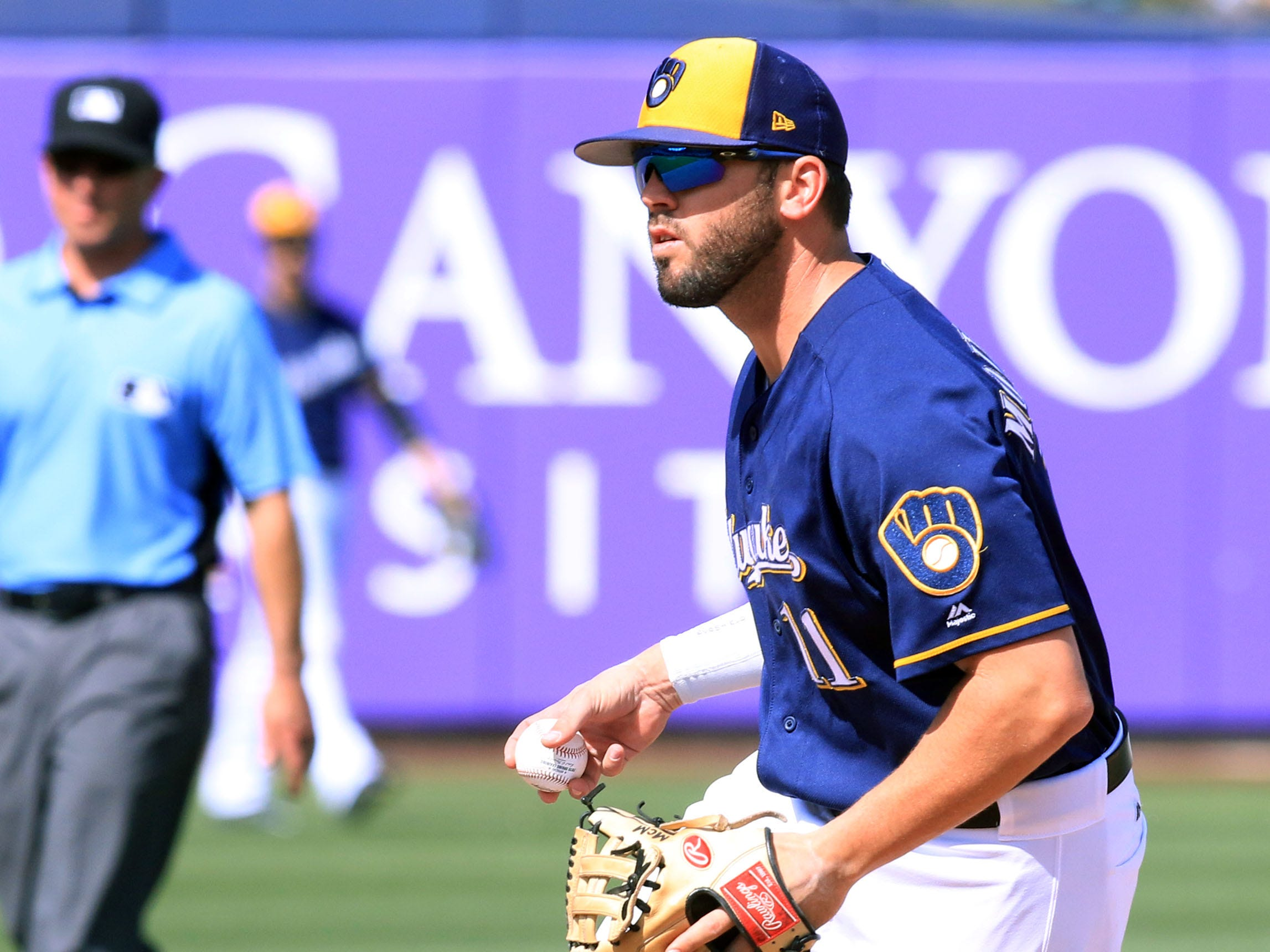 Milwaukee Brewers Mike Moustakas fields a grounder at second base.