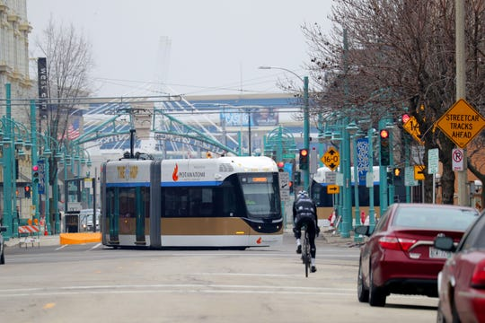 The Milwaukee streetcar, known as The Hop, travels on East St. Paul Avenue, turning north on North Water Street.