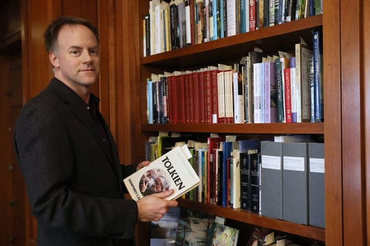 Marquette University archivist Bill Fliss leafs through JRR Tolkien's books in the John P. Raynor Library. Fliss has started collecting verbal stories about Tolkien fans, hoping to get 6,000 - the same number as the Riders of the Rohirrim in Lord of the Rings.