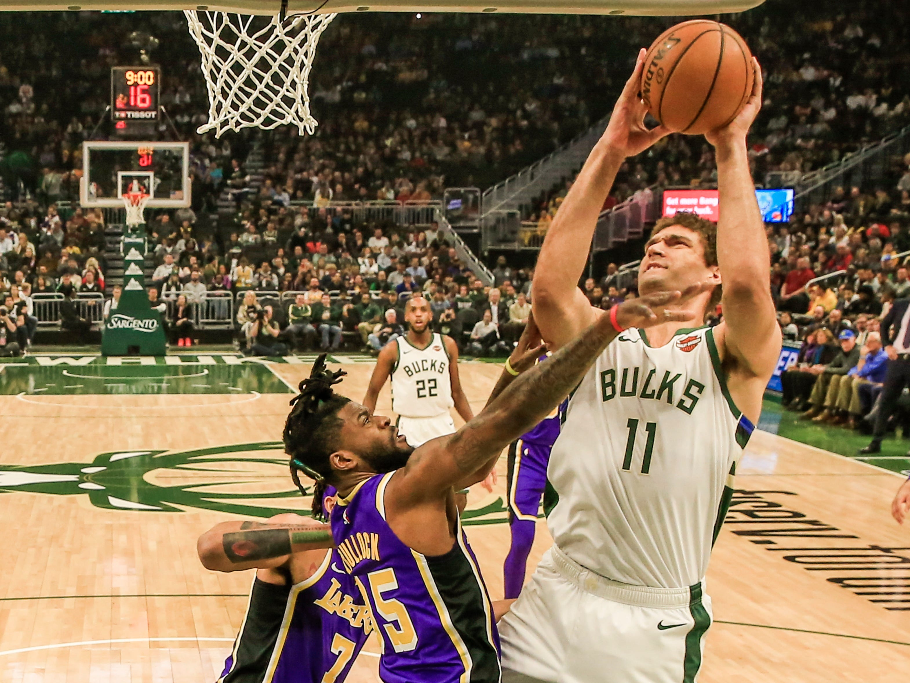 Brook Lopez gets position near the basket on Lakers guard Reggie Bullock.