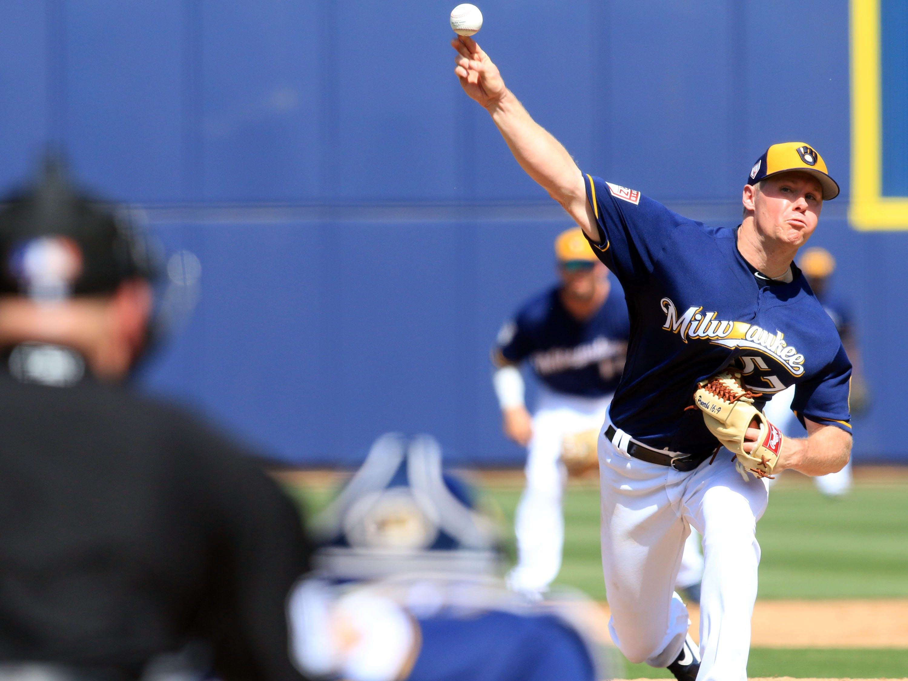 Brewers Chase Anderson delivers a pitch during the third inning.