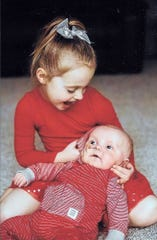 Cece McGrath plays with her little brother, Billy. At age 5, she was the donor for the boy's bone marrow transplant.
