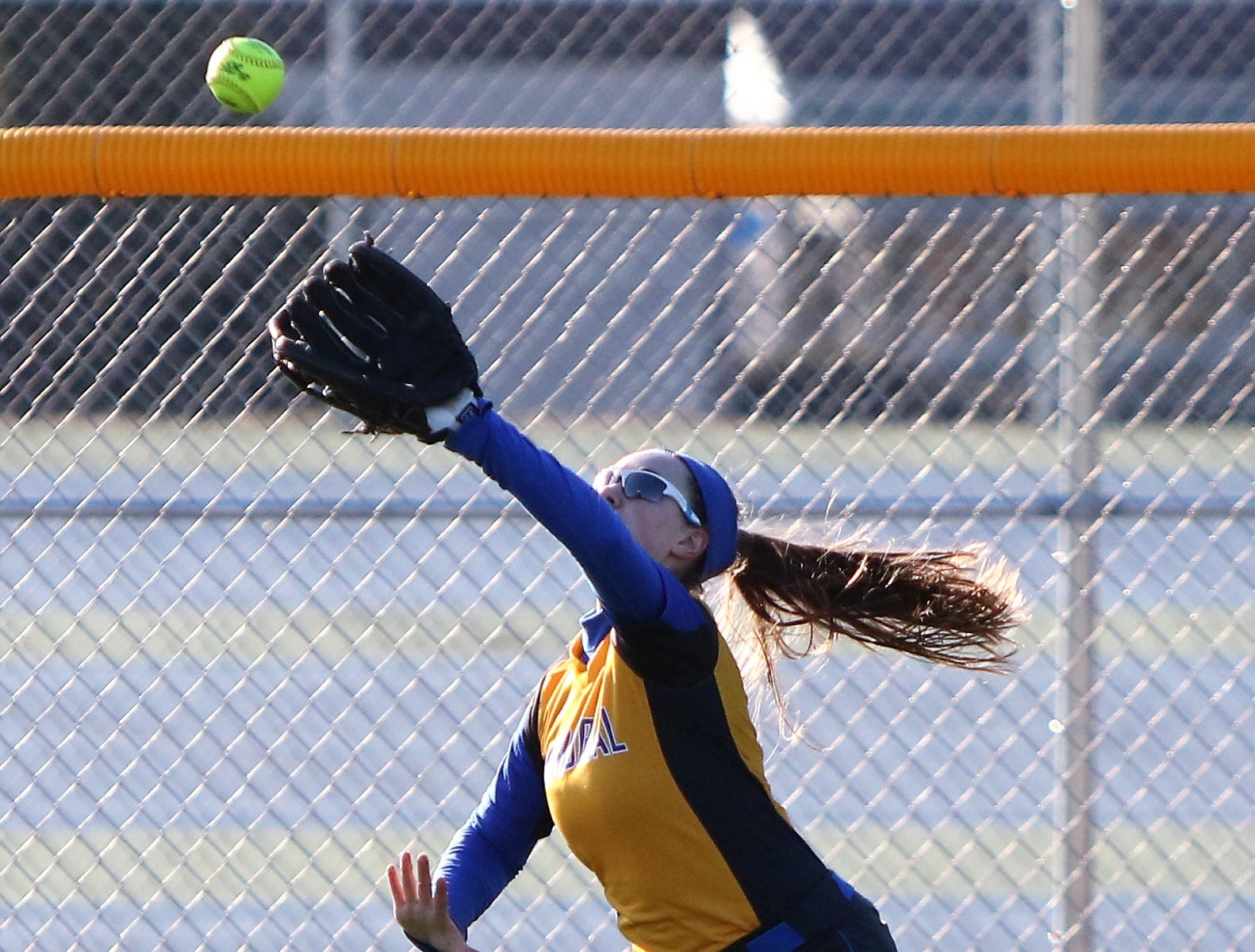 A Catholic Memorial outfielder makes a catch on a fly ball against Wauwatosa East on March 19, 2019.