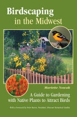 """Birdscaping in the Midwest"" is an excellent local manual for attracting birds."